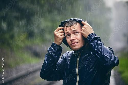 Photo  Traveler in heavy rain