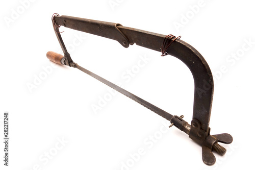 Fotografie, Obraz  Old rusty hacksaw, isolated on white background.
