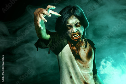 Scary zombies with blood and wound on his body walking Canvas Print