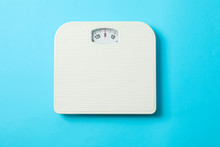 White Weigh Scales On Blue Background, Top View