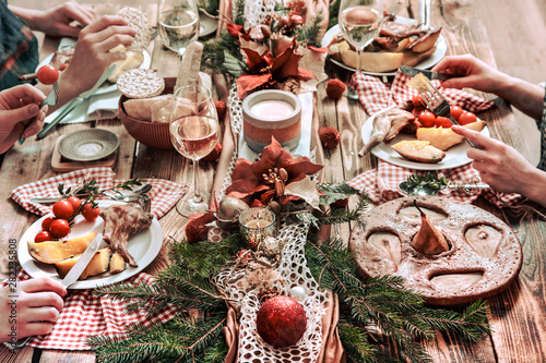 Fotografia, Obraz  Flat-lay of friends hands eating and drinking together