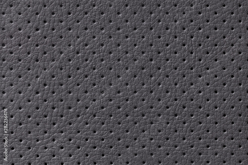 Fototapeta  Perforated black leather texture background, closeup
