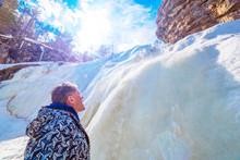 Beautiful Mature Tourist By A Frozen Waterfall
