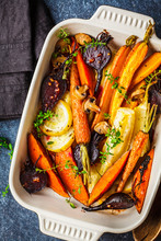 Baked Vegetables With Thyme In The Oven Dish, Blue Background.