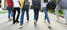 Unrecognizable Teenage Students In High School Campus