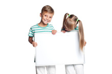 Little Boy And Girl Are Holding Empty Board, Isolated On White Background. Happy Smiling Children - Brother And Sister, With Blank Sign For Text.