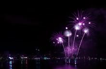 Impressive Vivid Purple Color Fireworks Splashing In The Night Sky Over The Harbor