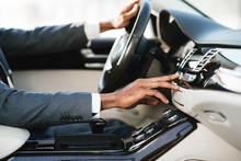 Afro Businessman Driving Car A...