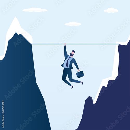 Obraz Businessman hanging over a cliff,business problem or crisis concept - fototapety do salonu