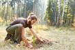 Leinwandbild Motiv Plant foresters at the tree for reforestation