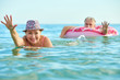 canvas print picture - OLD ADULT MAN AND WOMAN SWIM IN THE SEA TOGETHER