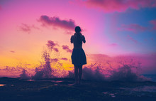 Girl Silhouette On Sunset Background