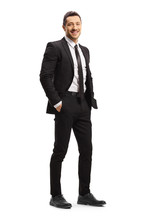 Young Man In A Black Suit Posing