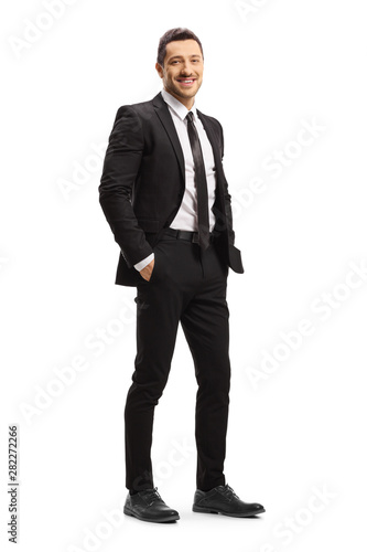 Tablou Canvas Young man in a black suit posing
