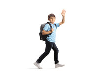 Schoolboy With A Backpack Runn...