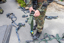 German Army Soldier Holds A Lashing Ratchet