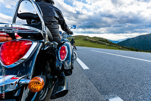 fototapeta na szkło Motorcycle driver riding in Alpine highway, Nockalmstrasse, Austria, Europe.