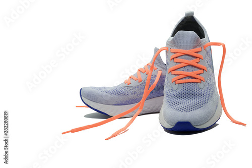 Fotomural  Shoelaceless running shoes on isolated white background with copy space