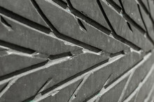 The Texture Of The Used Rubber Tire. Car Tire Tread Pattern