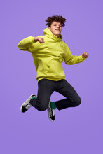 Stylish Teenager Jumping Up In Air