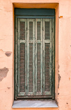 Windows With Green Wooden Shutters