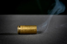Smoking Bullet Casing Dropped ...