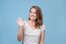Woman Smiling Happily, Saying Hello, Hi Or Bye