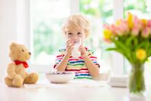 Child Eating Breakfast. Kid Wi...