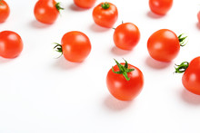 Bunch Of Juicy Organic Red Cherry Tomatoes Scattered On Isolated White Background. Polished Vegetables. Clean Eating Concept. Vegetarian Diet. Copy Space, Flat Lay, Top View.
