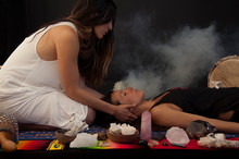 Somatic Shamanic Bodyworker Light Worker Woman Healing With Sage Smoke And Stone Crystals.