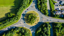 Aerial Long Exposure Of Traffic On A Roundabout In A Small Town