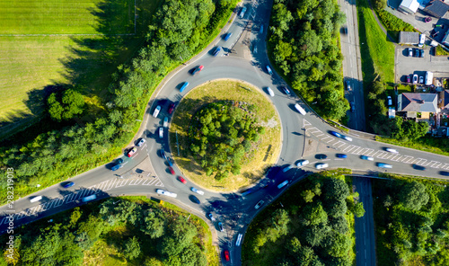 Obraz na plátně Composite aerial image of traffic using a small roundabout with multiple connect