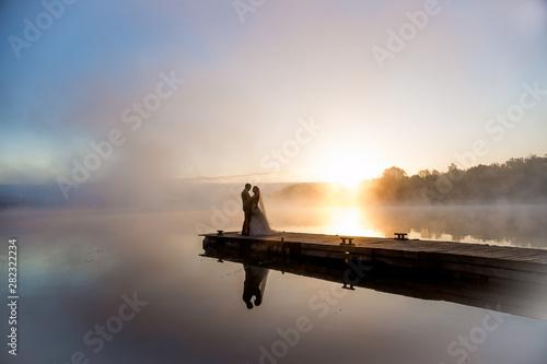 Tuinposter sunset on lake