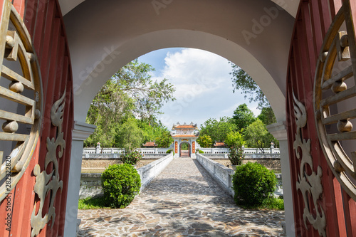 Fotografie, Tablou Hue, Vietnam - June 2019: view over traditional Vietnamese temple through open d