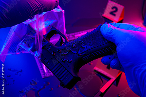 Foto Forensic science, murder weapon and criminal investigation concept theme with de