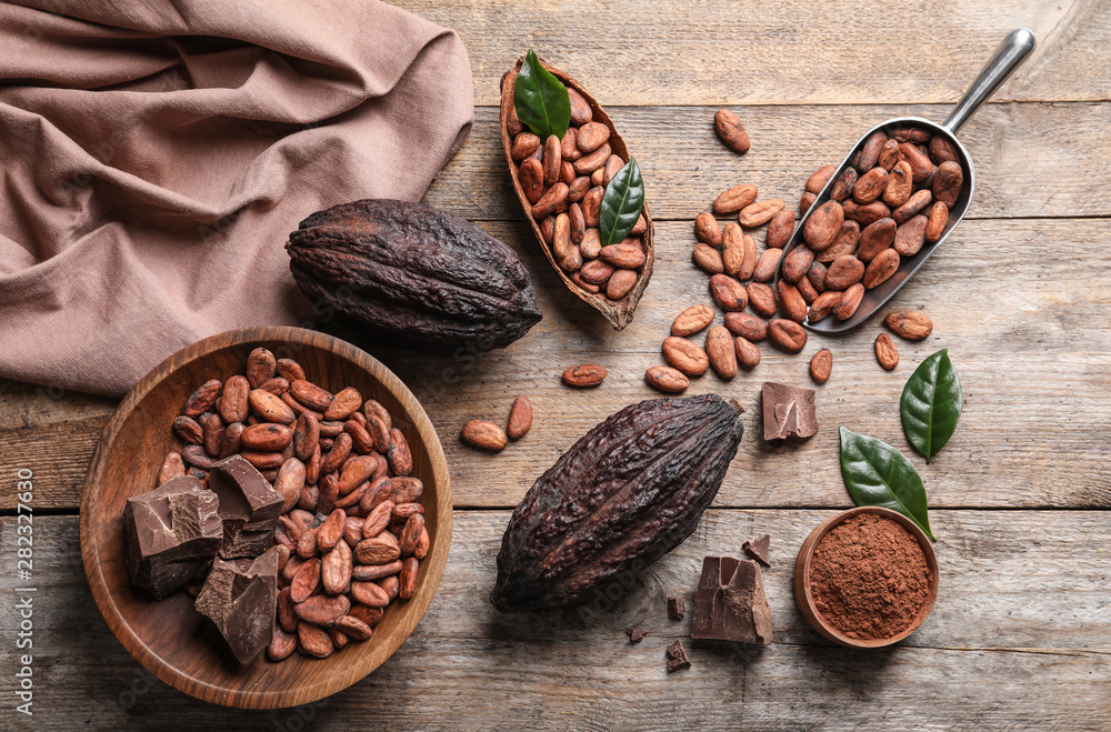Fototapety, obrazy: Flat lay composition with cocoa beans, chocolate pieces and pods on wooden table