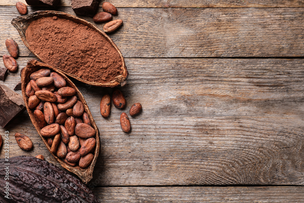 Fototapety, obrazy: Flat lay composition with cocoa pods and beans on wooden table. Space for text