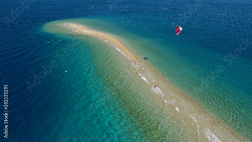 Türaufkleber Blau türkis Aerial drone photo of kite surfer practising in tropical exotic sandbar part of island Atoll with turquoise and emerald open ocean sea