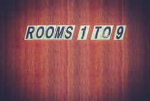 Grungy Hotel Rooms Sign