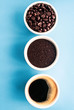 cup of coffee with beans on blue background