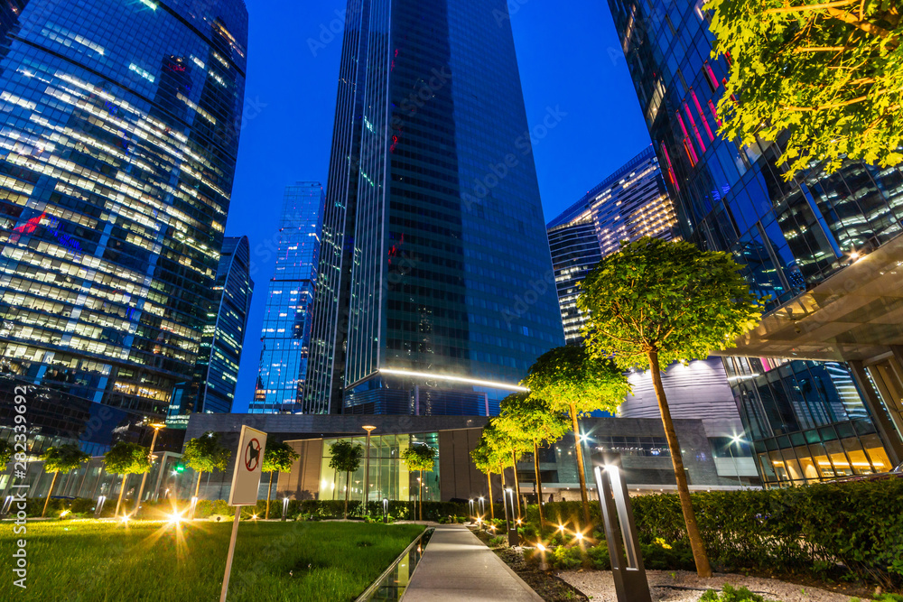 Fototapety, obrazy: Modern skyscrapers in business district. Night architecture. International business centre at twilight time