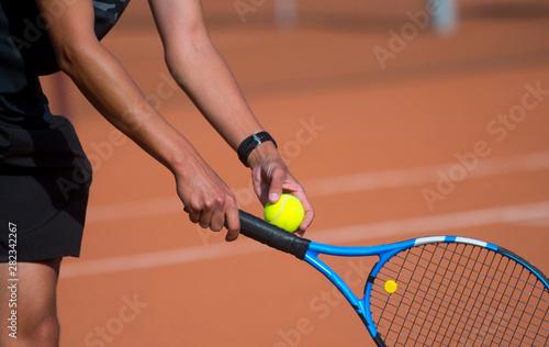 Fotografia, Obraz A tennis player prepares to serve a tennis ball during a match