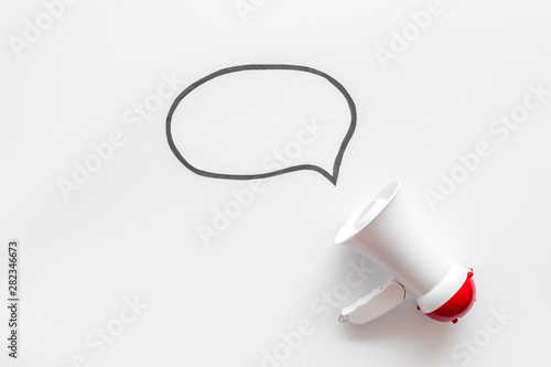Megaphone with bubble for announcement text on white background top view space f Billede på lærred