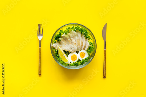 fototapeta na ścianę meal in bowl to take away on yellow background top view