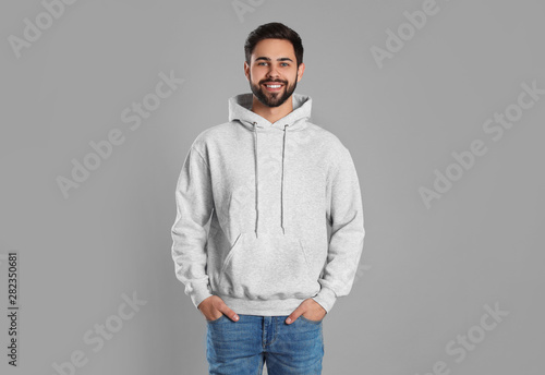 Obraz Portrait of young man in sweater on grey background. Mock up for design - fototapety do salonu