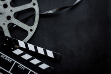 Go To The Cinema With Film Type And Clapperboard On Black Background Top View Mock Up