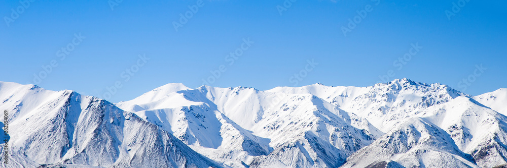 Fototapety, obrazy: Mountain peaks snow covered mountain range with blue sky