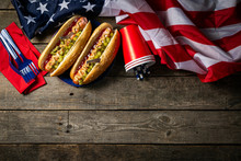 USA National Holiday Labor Day, Memorial Day, Flag Day, 4th Of July - Hot Dogs With Ketchup And Mustard On Wood Background