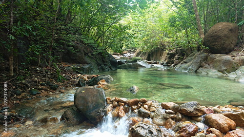 Montage in der Fensternische Forest river National park Waterfall in to the Thailand jungle