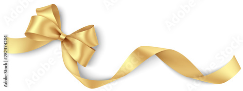 Stampa su Tela Decorative golden bow with long ribbon isolated on white background